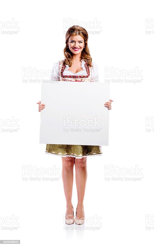 Woman in bavarian dress, studio shot, copy space stock photo