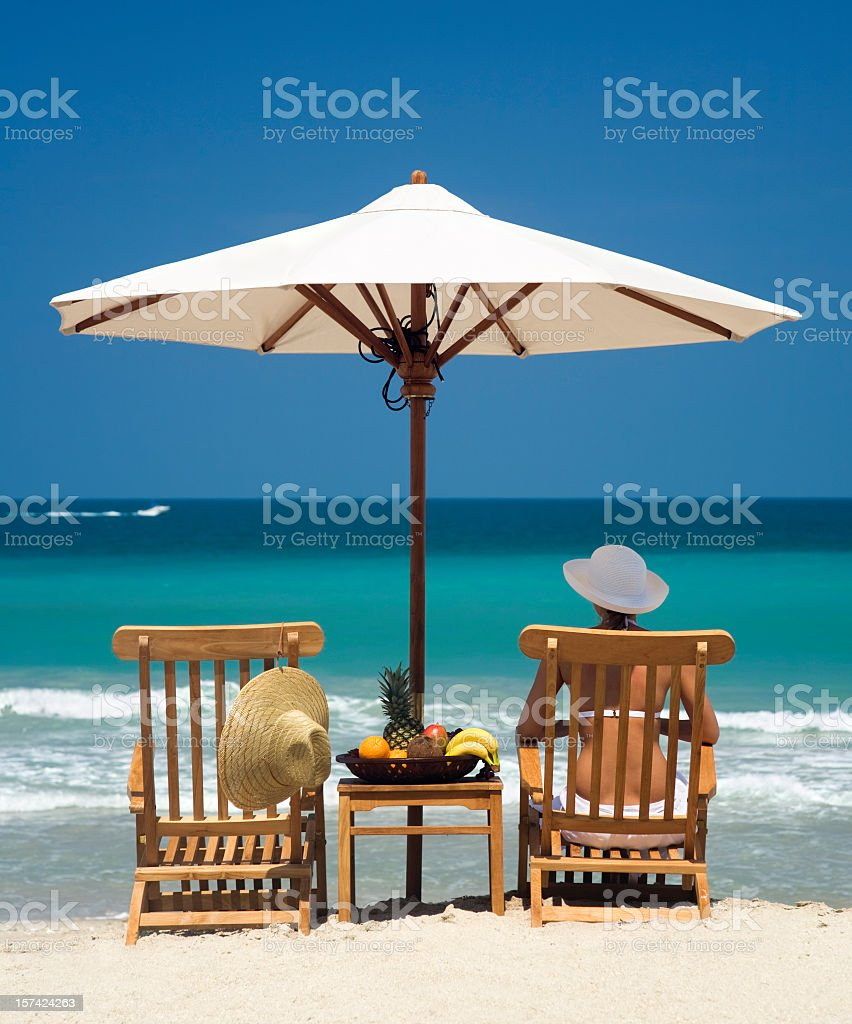 woman in beach chair royalty-free stock photo