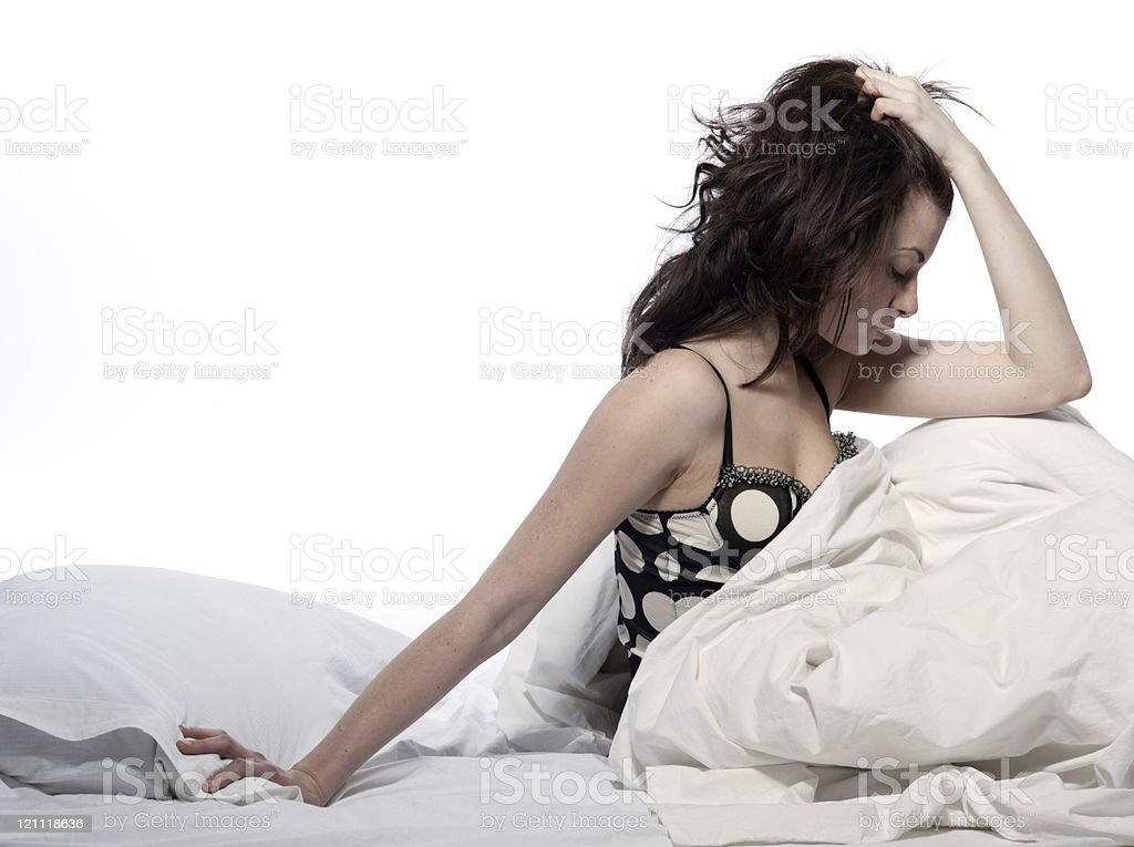 woman in bed awakening stock photo