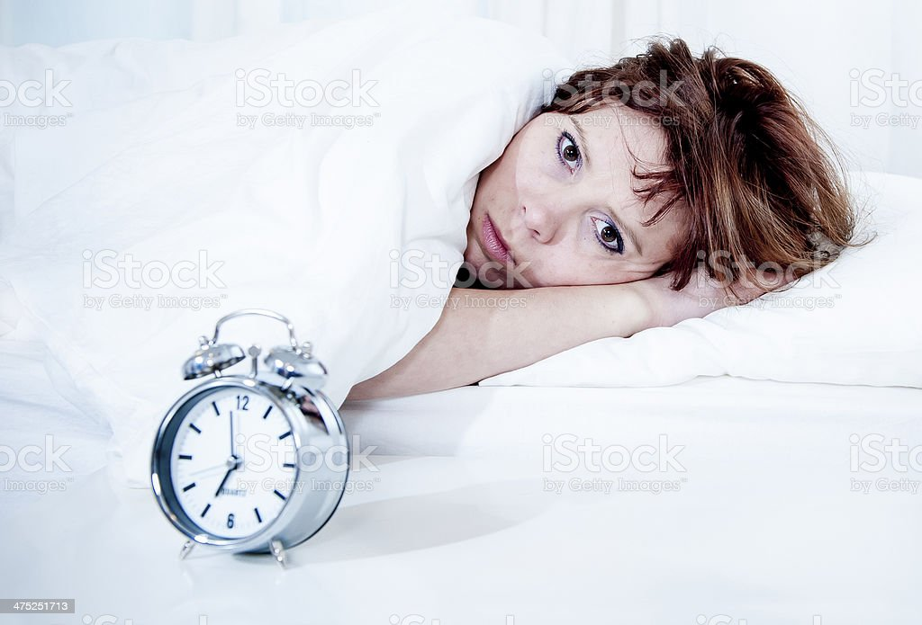 woman in bed with insomnia that can't sleep white background royalty-free stock photo