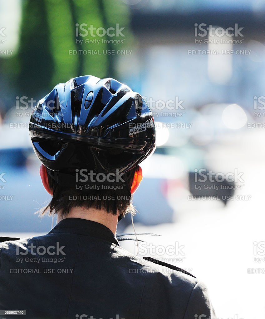 woman in bicycle helmet seen from behind stock photo