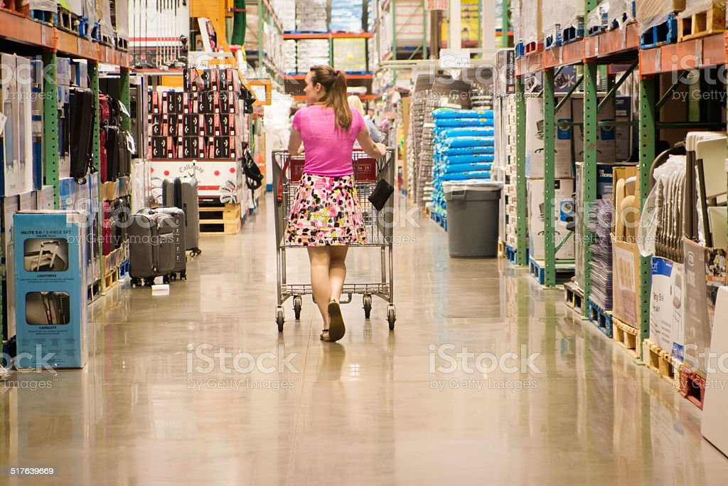 Woman in Big Box Store Shopping with Cart stock photo