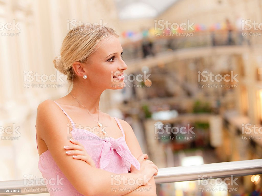 Woman in big hall at handrail royalty-free stock photo