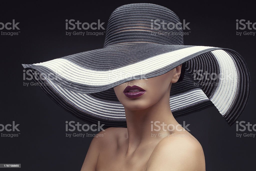 Woman in big summer hat stock photo