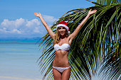 Woman in bikini celebrating Christmas