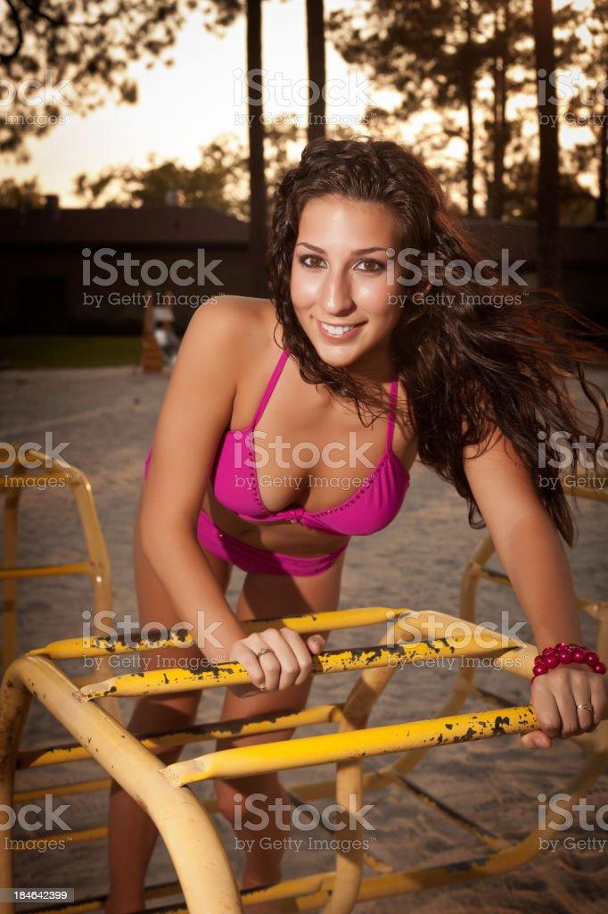 Woman in bikini on playground equipment royalty-free stock photo