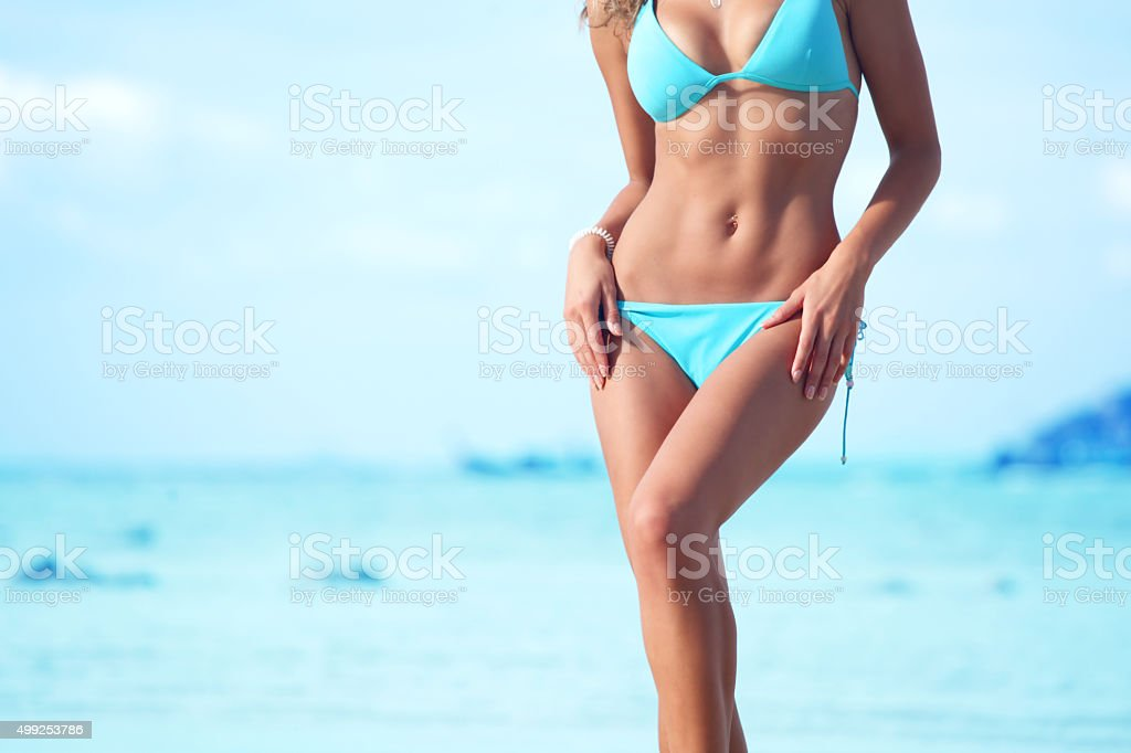 Woman in bikini on sea background stock photo