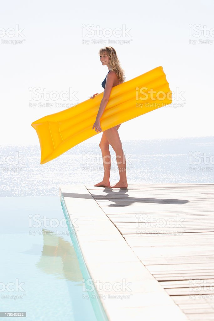 Woman in bikini with flotation device outdoors royalty-free stock photo