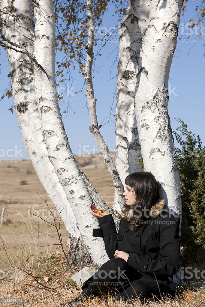 Woman in Black Coat with Birch Leaves royalty-free stock photo
