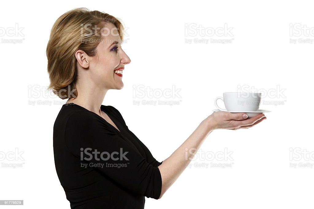 woman in black dress offering tea/coffee isolated on white stock photo