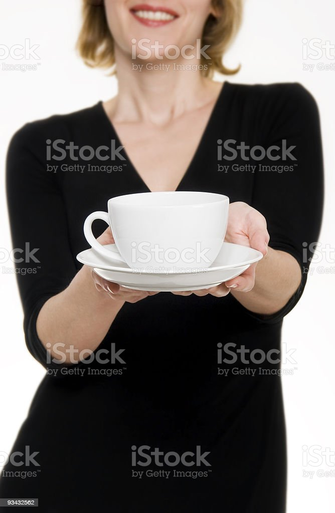 Woman in black dress offering tea/coffee royalty-free stock photo