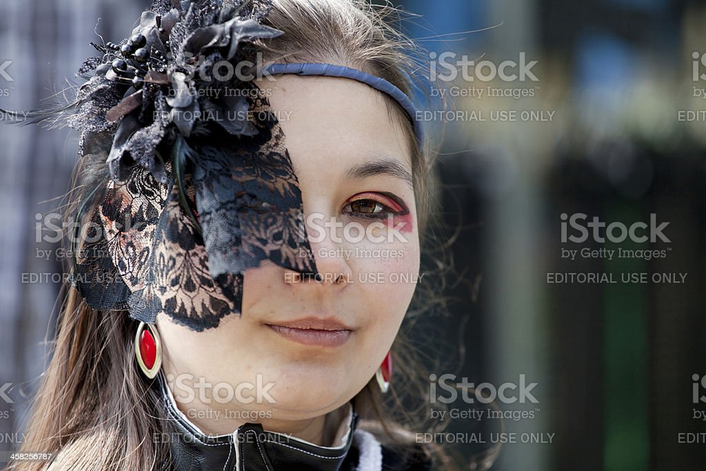 Woman in black dressed up for Fantasy Fair royalty-free stock photo