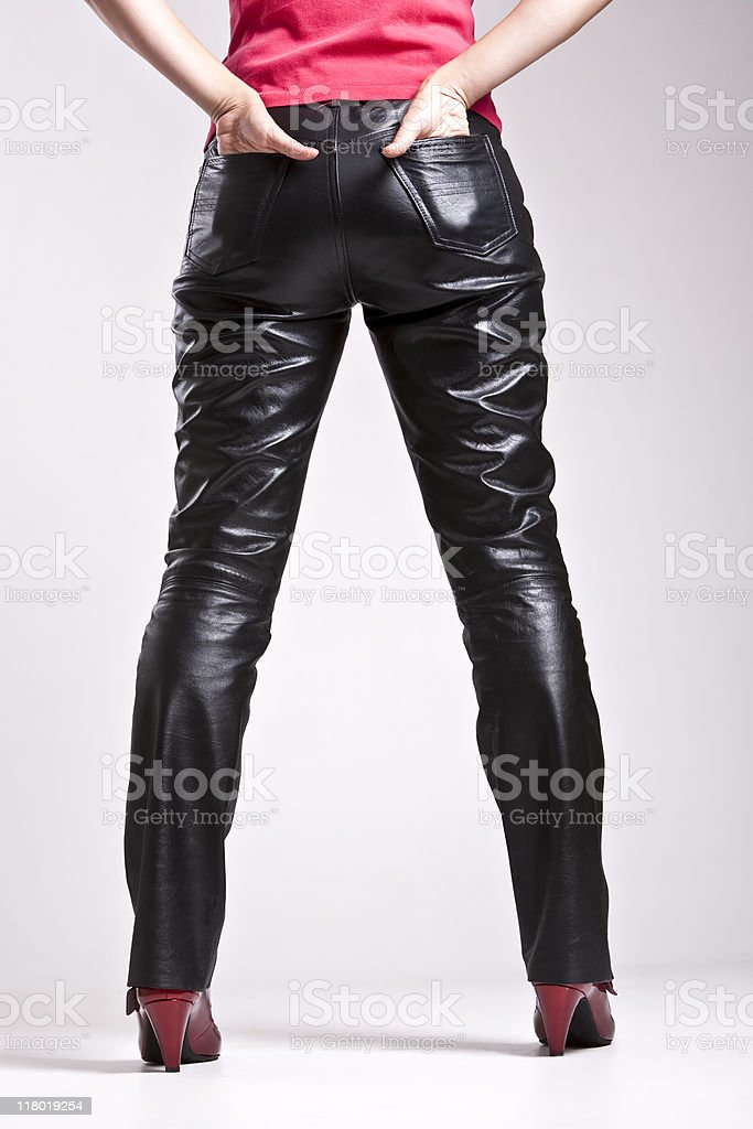 Woman in black leather pants stock photo