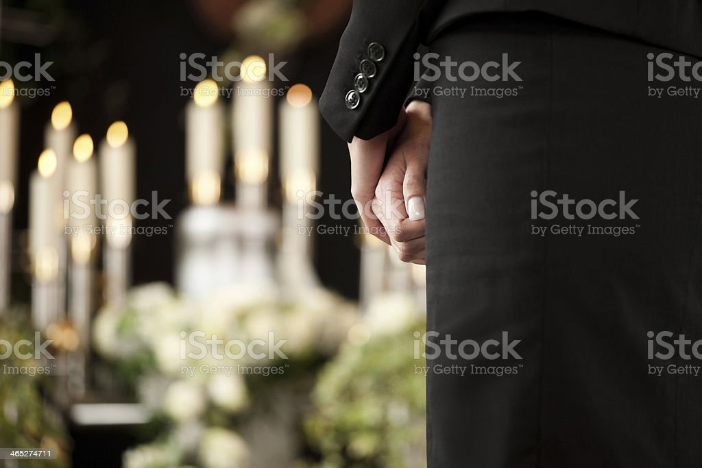 Woman in black mourning at a funeral stock photo