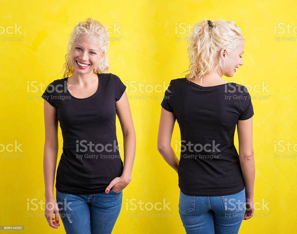 Woman in black round neck T-shirt on yellow background stock photo