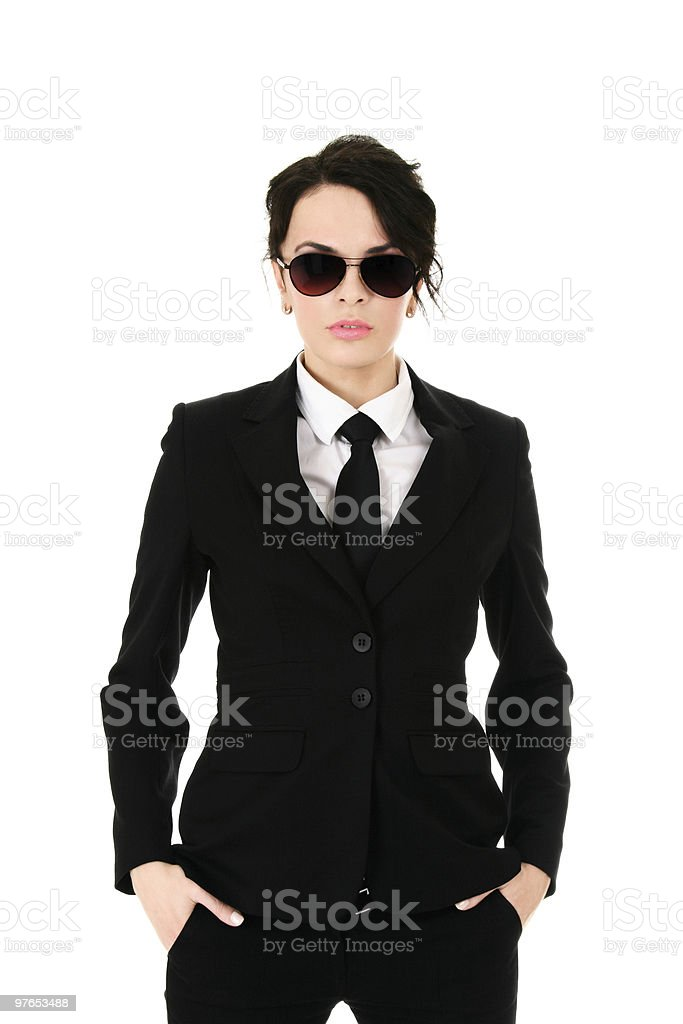 Woman in black suit wearing sunglasses and hands in pocket stock photo