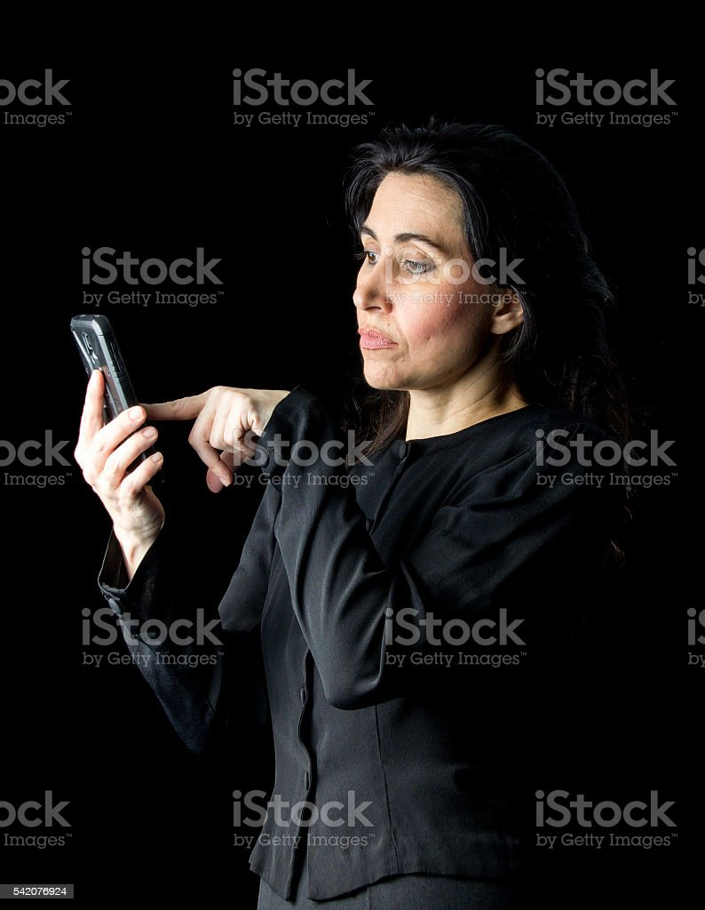 Woman in Black Using Cell Phone stock photo