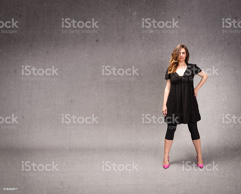 woman in black with empty space on background stock photo