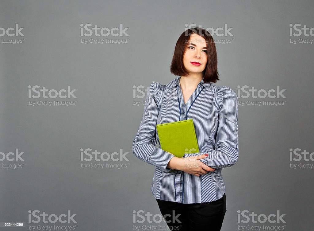Woman in blue blouse standing and keep her green notes stock photo