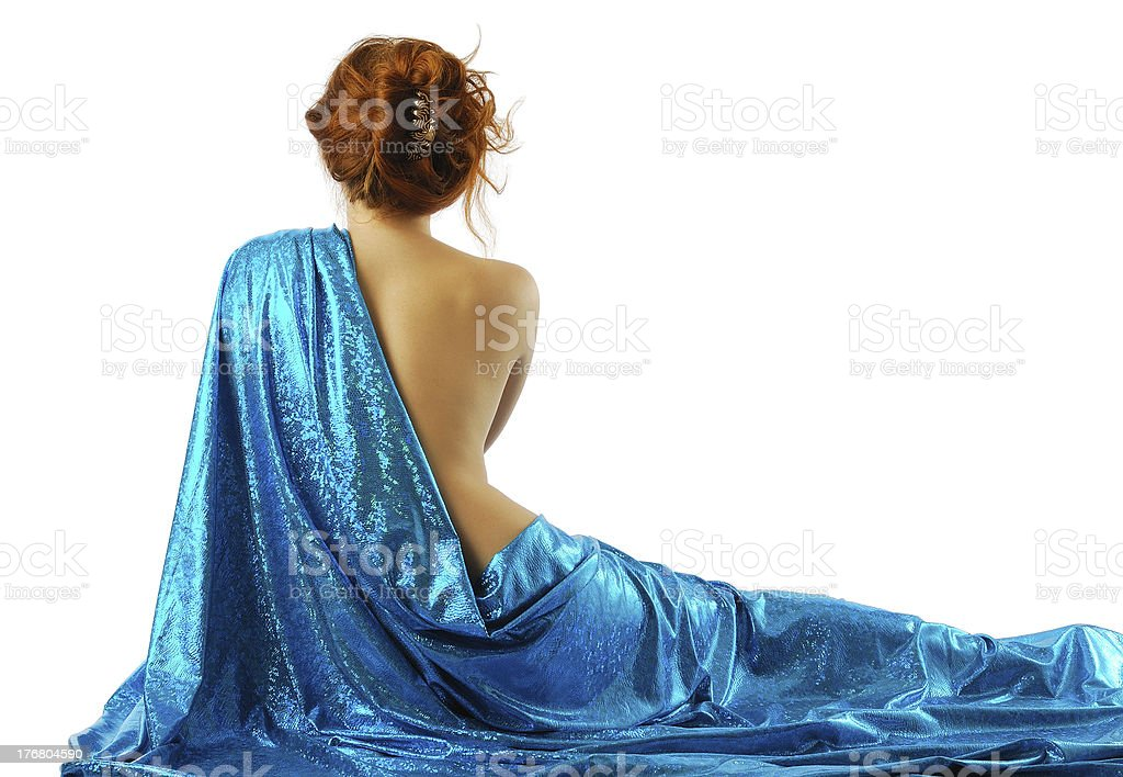 Woman in blue cloth, rear view. stock photo