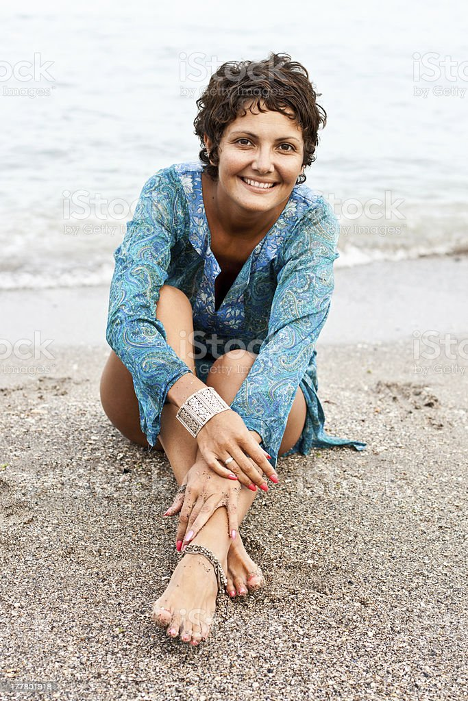 woman in blue dress on the beach royalty-free stock photo