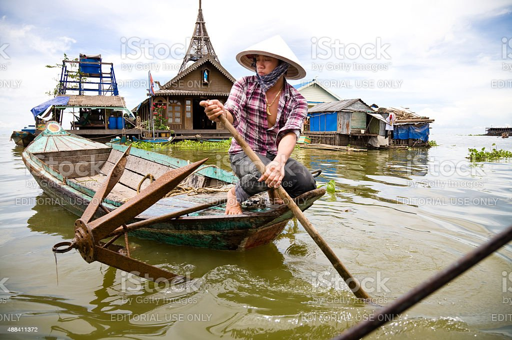 Woman in boat, Tonle Sap, Cambodia stock photo