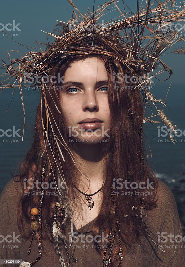 Woman in Boho Fashion with Head Wear Crown of Hay stock photo