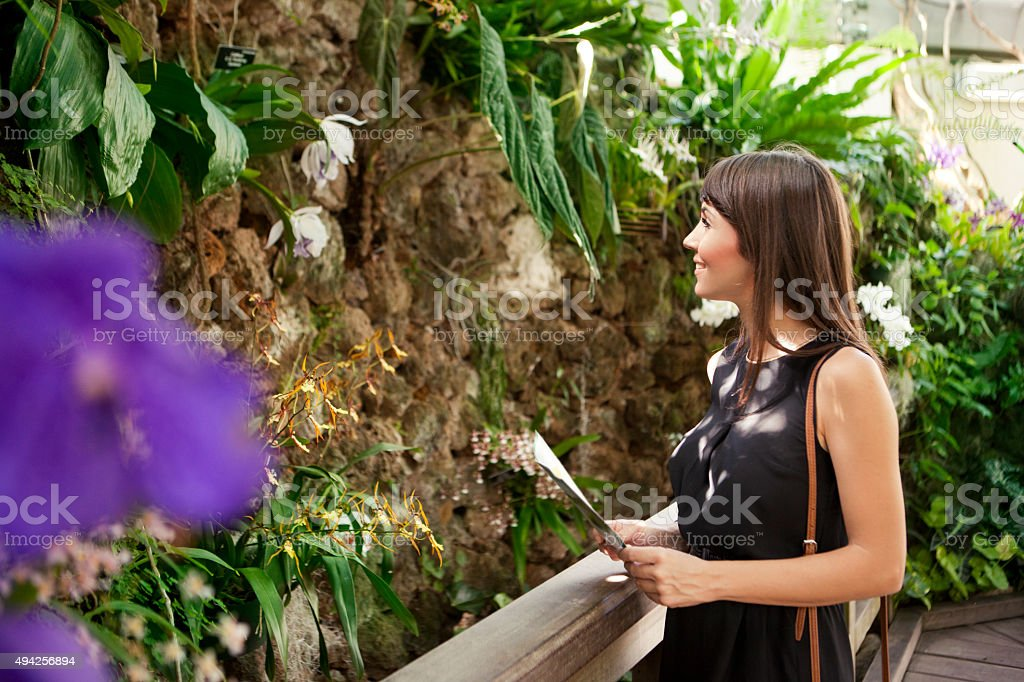Woman in botanical garden stock photo