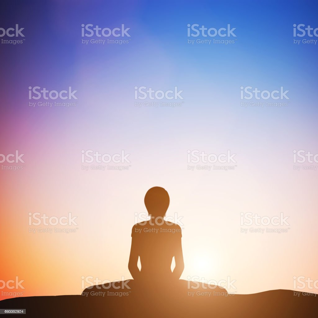 Woman in bound angle yoga pose meditating at sunset. Zen stock photo