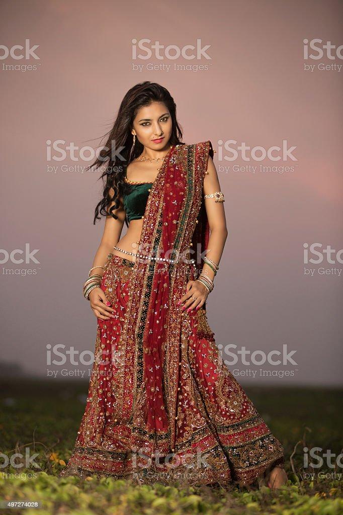 Woman in bright red lehenga choli stock photo