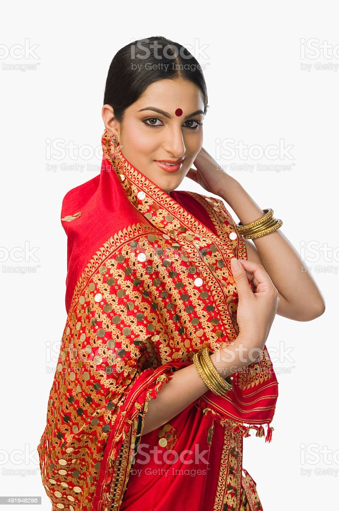 Woman in bright red mekhla stock photo