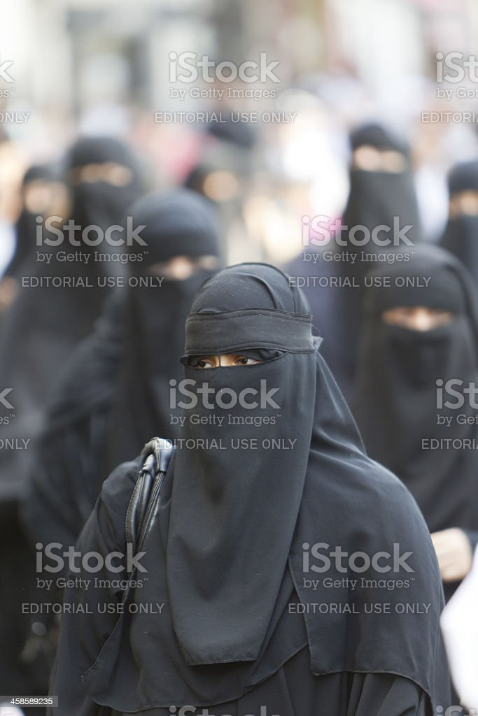 woman in burka stock photo
