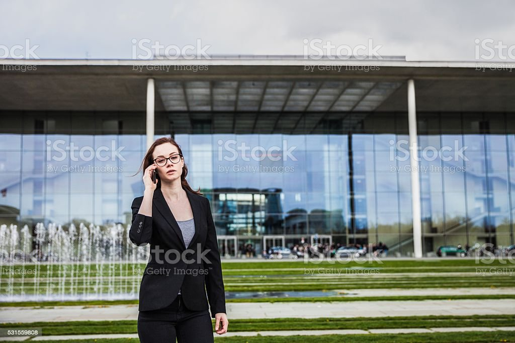 Woman in business outside the office building in downtown stock photo
