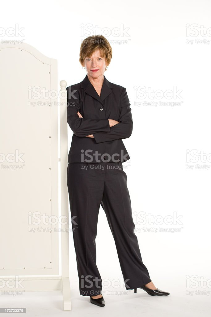 Woman in business suit leaning royalty-free stock photo