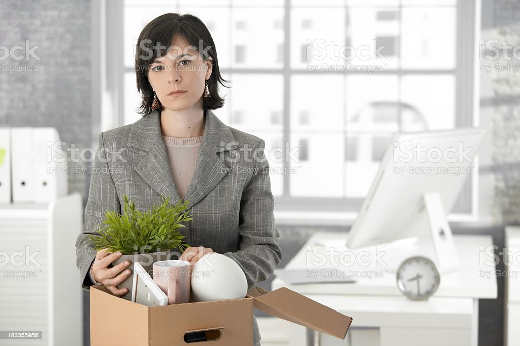 Woman in business suit with distressed expression is fired stock photo