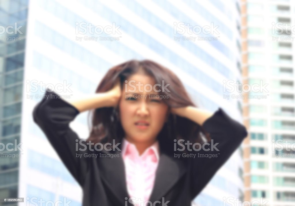 woman in business suite with  angry face stock photo