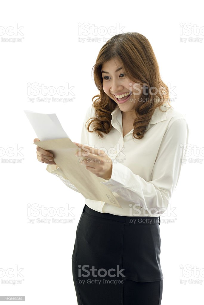 Woman in business wear reading something delightful stock photo