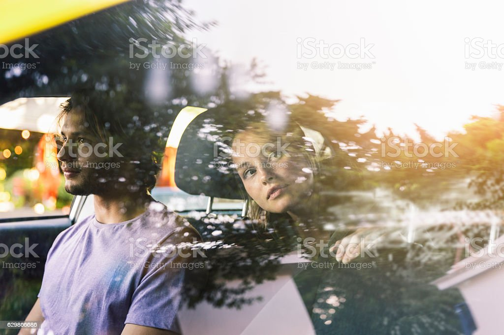 Woman in cab looking out reflected window stock photo