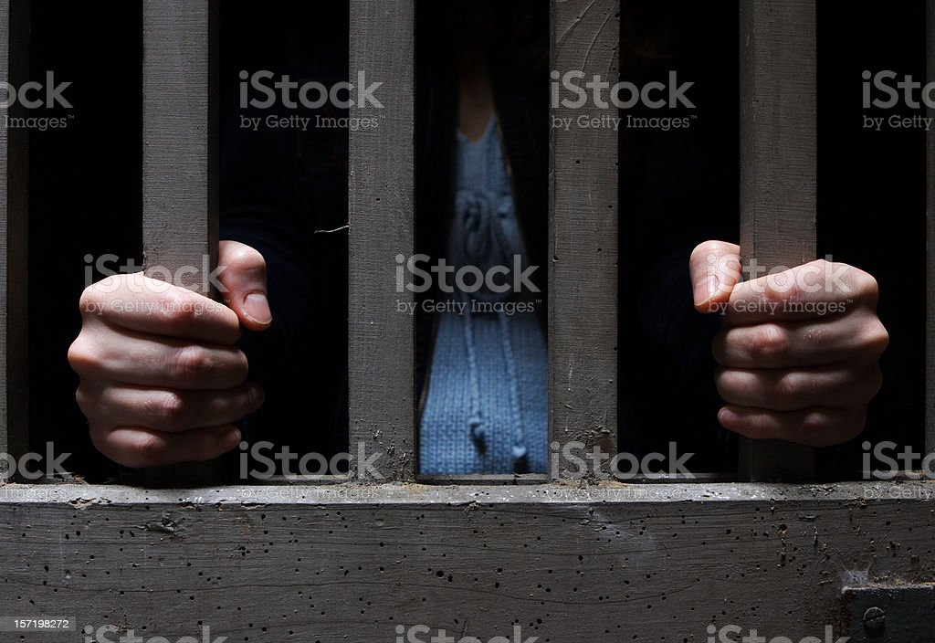 Woman in cage stock photo
