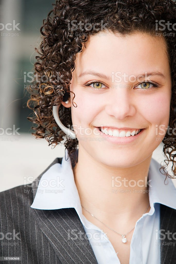 Woman in Call Center with Headset royalty-free stock photo