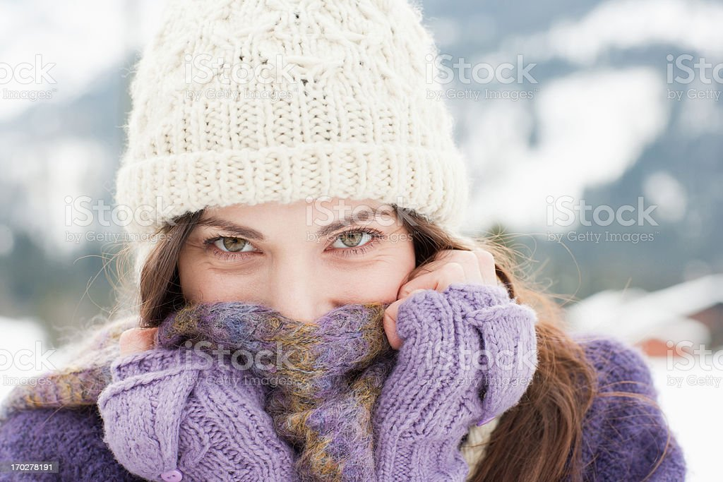 Woman in cap, scarf and gloves stock photo