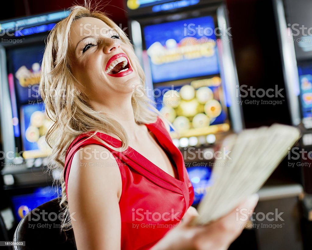 Woman in casino winning at slot machine. royalty-free stock photo
