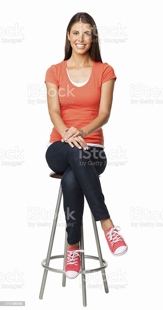 Woman In Casuals Sitting On Stool - Isolated stock photo
