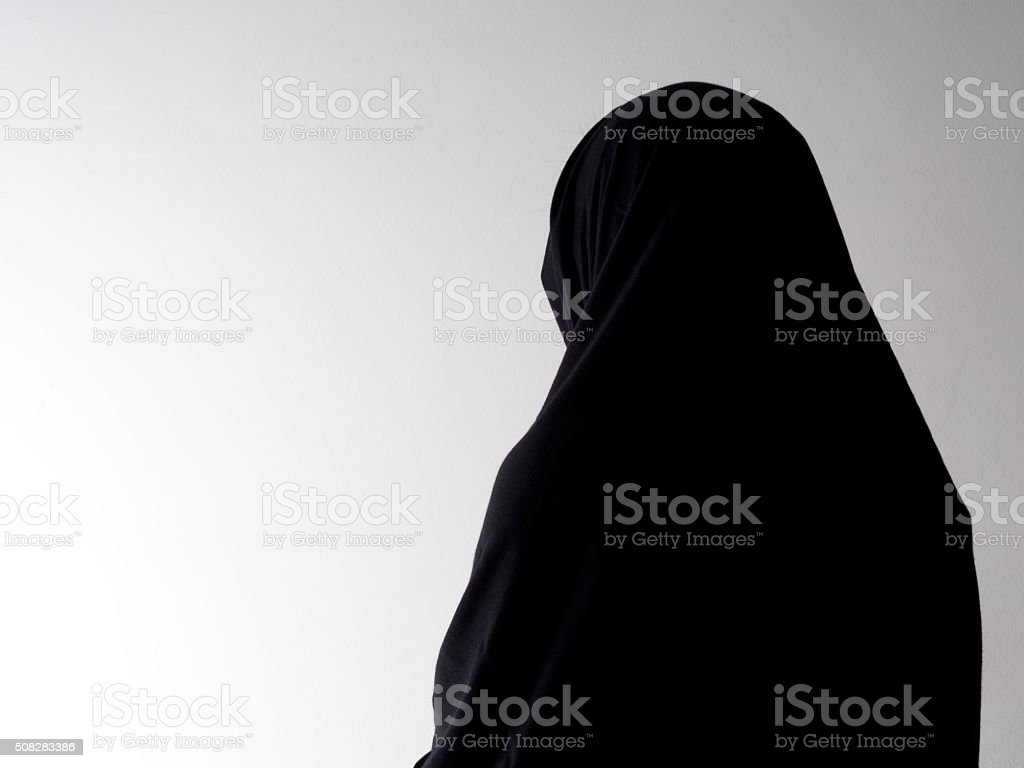 Woman in chador from behind, with copyspace. stock photo