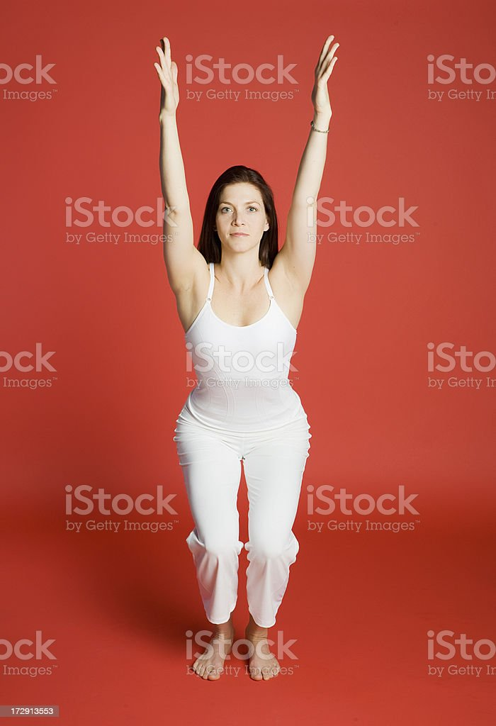 Woman in chair pose stock photo