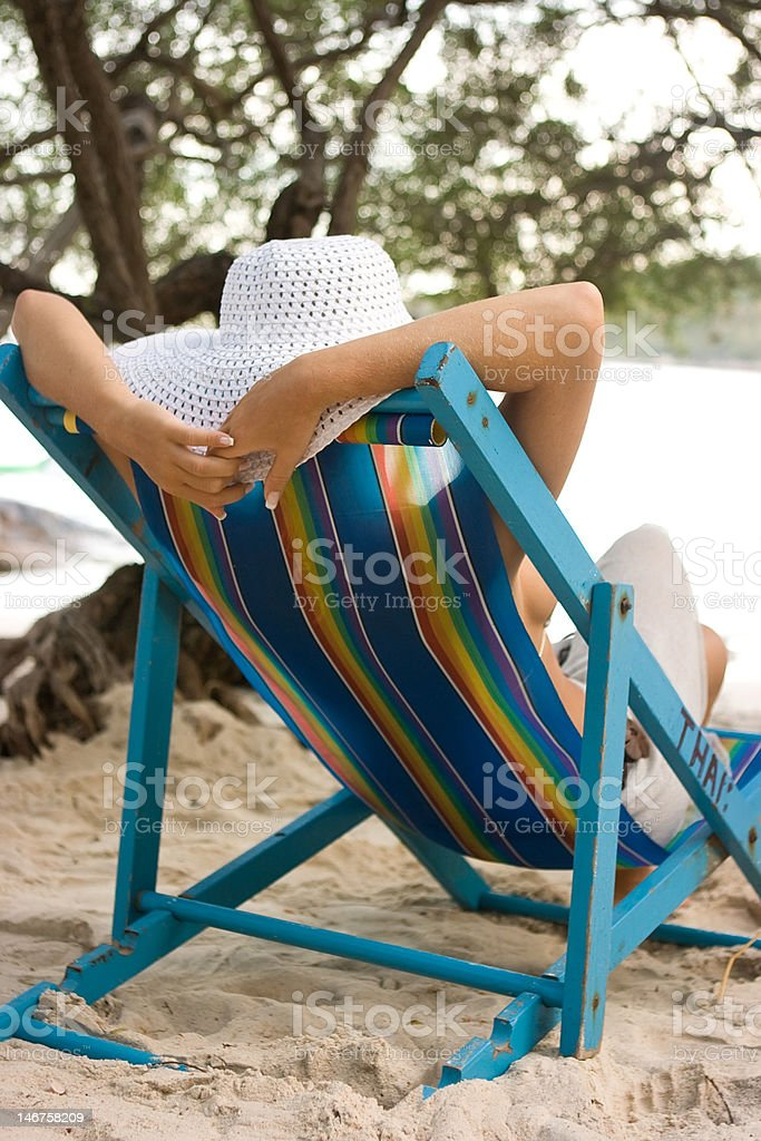 Woman in chaise longue royalty-free stock photo