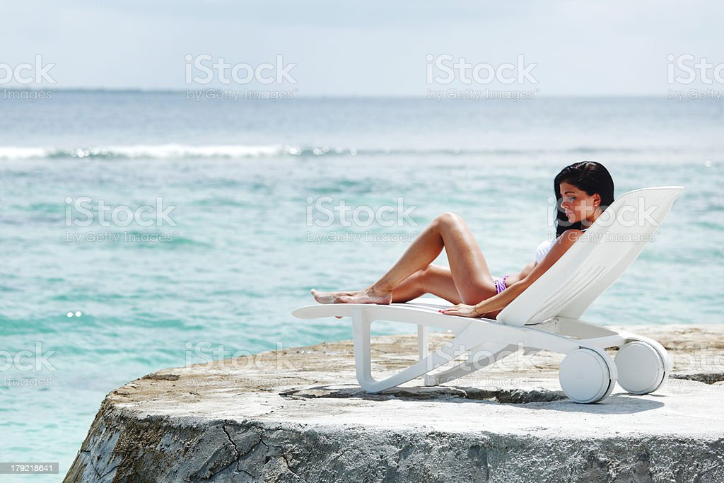 Woman in chaise-lounge near sea royalty-free stock photo