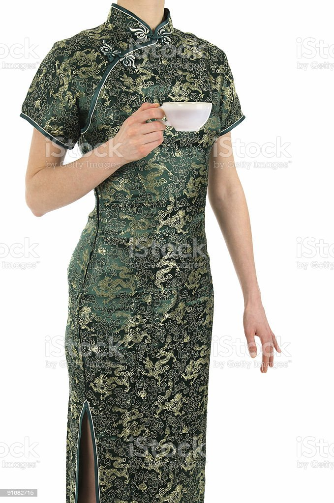 Woman in Chinese dress with a cup of tea royalty-free stock photo