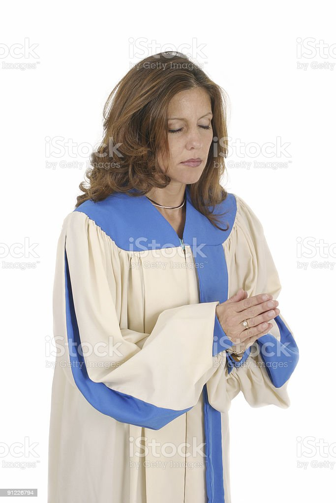 Woman In Choir Robe Praying royalty-free stock photo