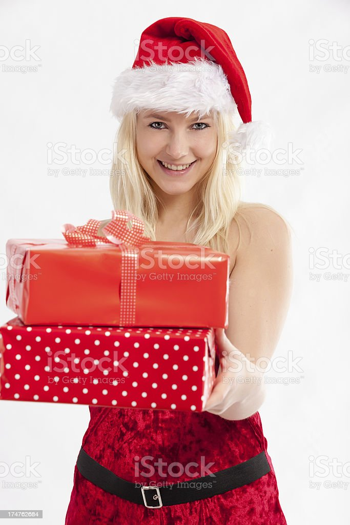 Woman in Christmas dress holding presents stock photo